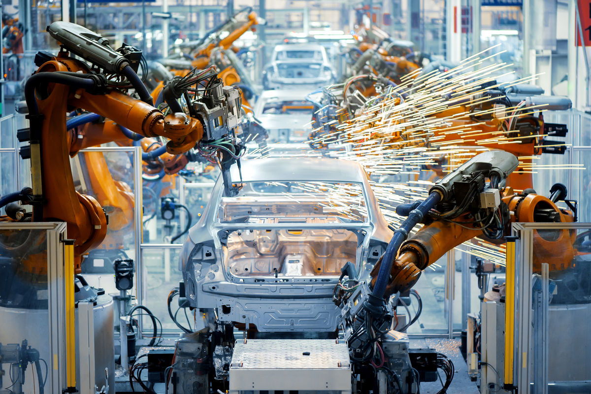 Assembly line with robotic arms