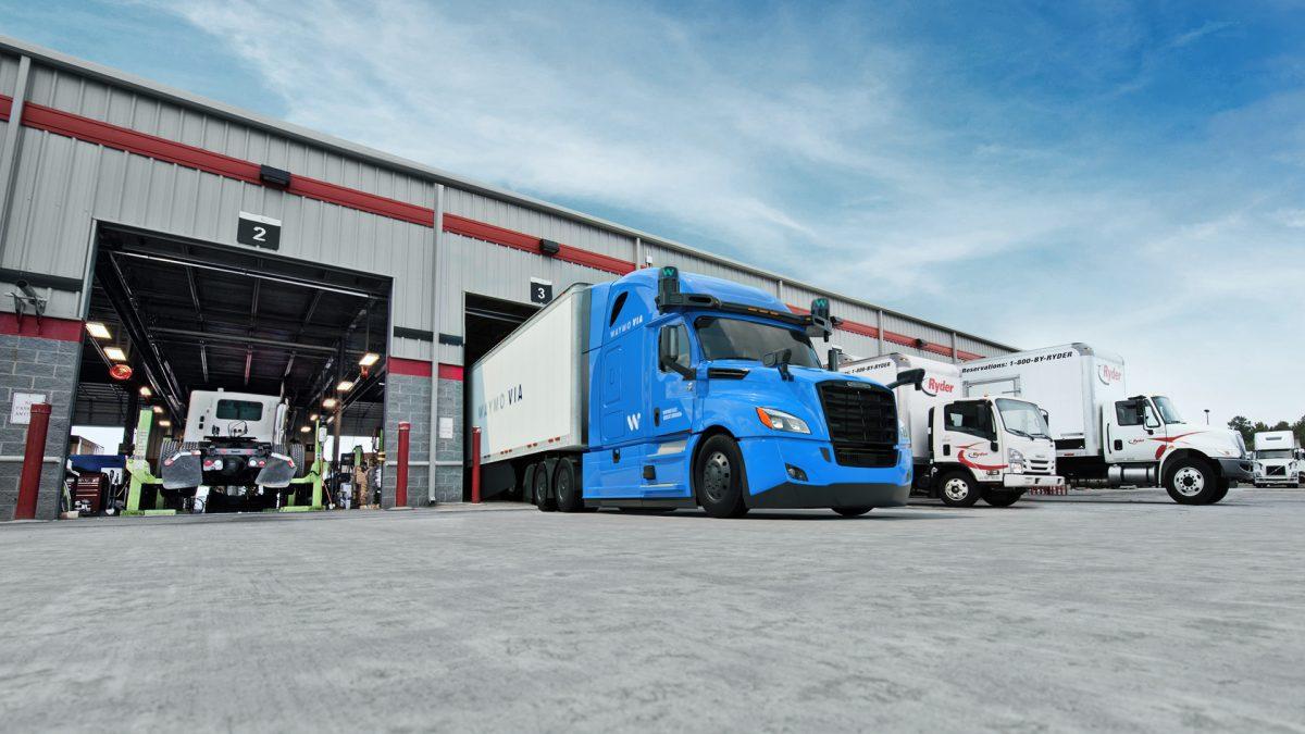 Waymo Via long-haul trucks at depot